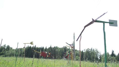 pinwheel windmills collection set spin between high grass Footage