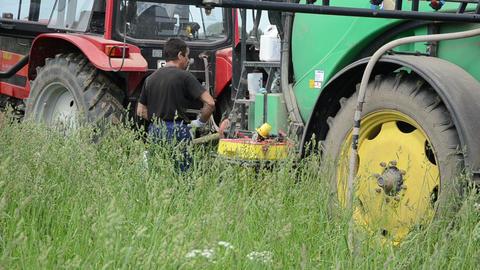 farmer preparing to tractor fertilizer spraying crops... Stock Video Footage