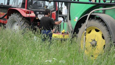 farmer preparing to tractor fertilizer spraying crops parasites Footage