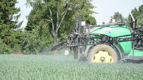 rural worker fertilizing fields pesticides along the farmstead Footage