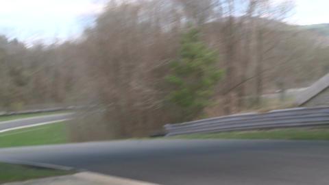 Speeding down a raceway (1 of 8) Stock Video Footage