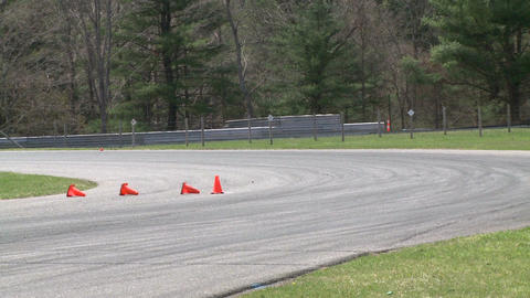 Racing cars speeding down a track (1 of 8) Stock Video Footage