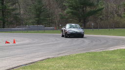 Racing cars speeding down a track (1 of 8) Footage
