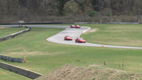 Racing cars speeding down a track (6 of 8) Stock Video Footage