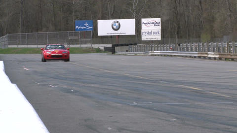 Race cars zooming around a track (5 of 8) Stock Video Footage