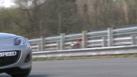 Race cars zooming around a track (7 of 8) Stock Video Footage