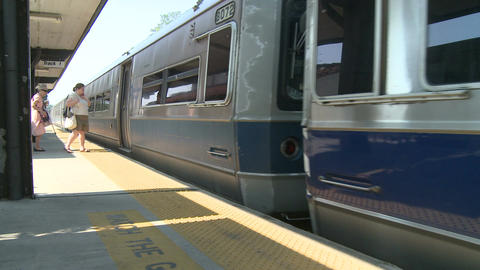 People getting on local train Stock Video Footage