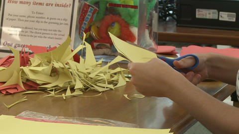 Child cutting out construction paper(1 of 2) Stock Video Footage