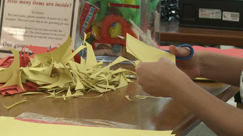 Child Cutting Out Construction Paper(1 Of 2) stock footage