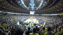 1080 Basketball game with yellow shirt fans Stock Video Footage