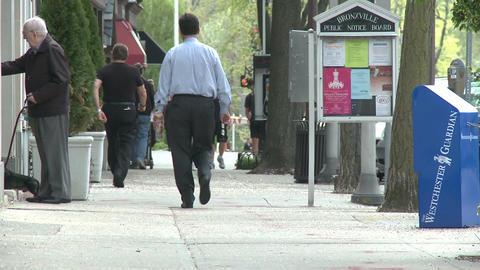 People walking down sidewalk on Main Street (1 of 5) Stock Video Footage