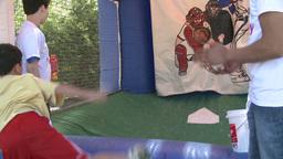 Kid enjoying pitching (1 of 1) Stock Video Footage