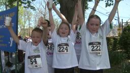 Children enjoying Marathon (1 of 1) Stock Video Footage
