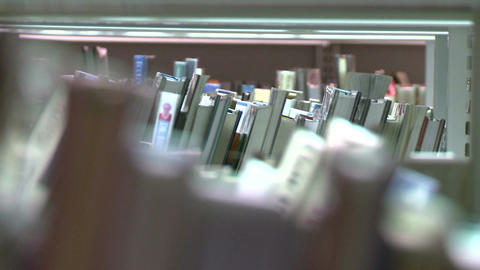 Looking through the book shelves at the library (1 of 3) Footage