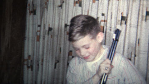 (8mm Vintage) 1965 Kid Gets BB Gun For Christmas. Don't Shoot Your Eye Out Footage