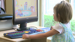Small child using a computer at the library (2 of 3) Footage