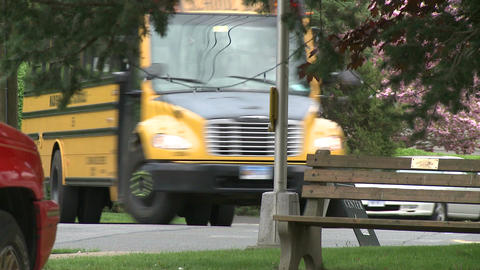 A school bus coming through town on its route (1 of 2) Live Action