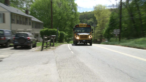School bus heading down road Live Action