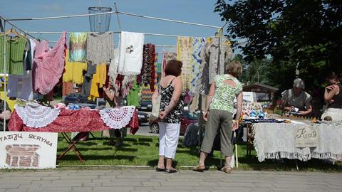 city needlework festival hand knitted crocheted women wear Footage