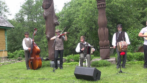 folklore group of guys playing in park folk musical instruments Footage