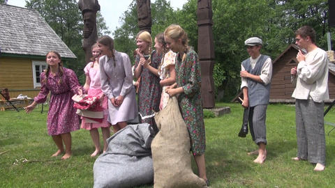 girls linen colored dresses laugh telling stories to each other Footage