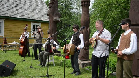 young man country band playing live folk music with instruments Footage