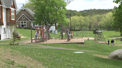 Children on swings at small playground Footage