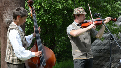 Musicians folk artists play music with contrabass and viola Footage