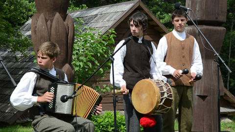 Young musicians boys play folk music with accordion and drum Footage