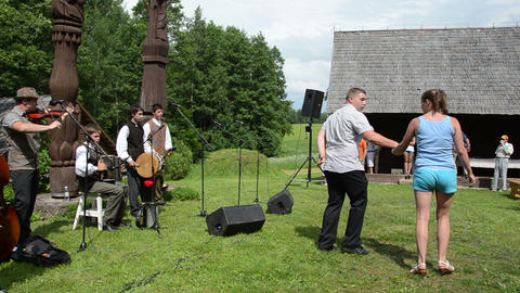 Country musicians play folklore music sing and pair dance Footage