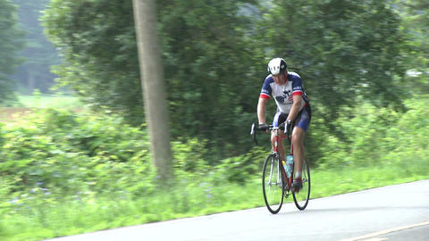 A cyclist riding his bike in the rural countryside Footage