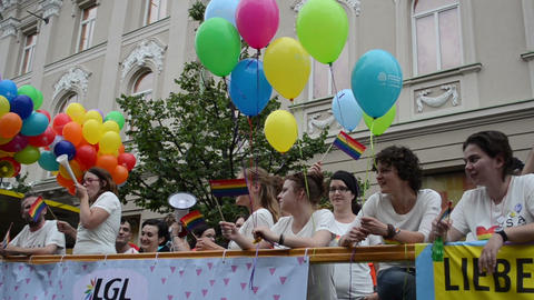 Happy gay people in open bus. Equality demonstration parade Footage