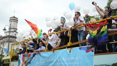 Baltic pride gay lesbian parade bus with banners balloons flags Footage