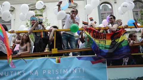 open bus rides participants Baltic pride gay parade flags Footage