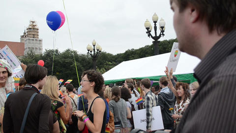 gay parade participants expressing wishes raise banners high Footage