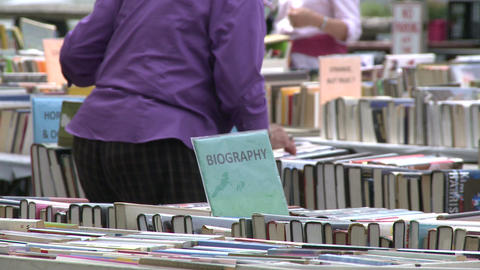 Books being displayed at an outdoor book fair (3 of 4) Live Action