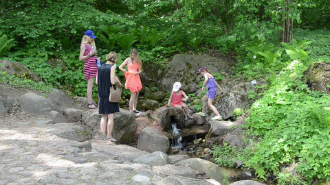 Family enjoy fresh source spring water in hot summer day Footage