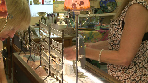 Woman looking at jewelry at a boutique Live Action
