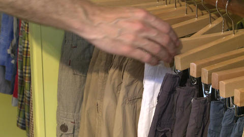 Man looking at a pant rack in a Country Store Live Action