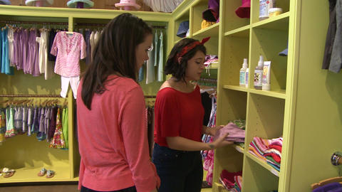 Women looking at different items at a Children's Boutique (2 of 4) Live Action