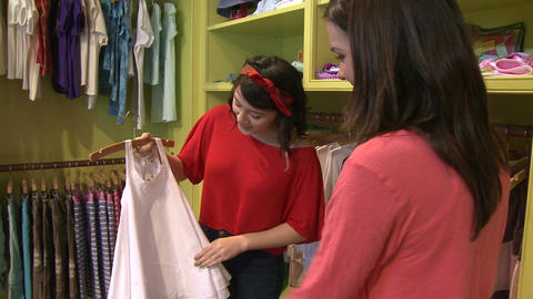 Women looking at different items at a Children's Boutique (4 of 4) Live Action