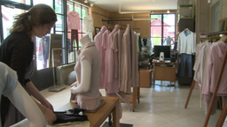 Woman looking in a designer clothing store (4 of 4) Live Action