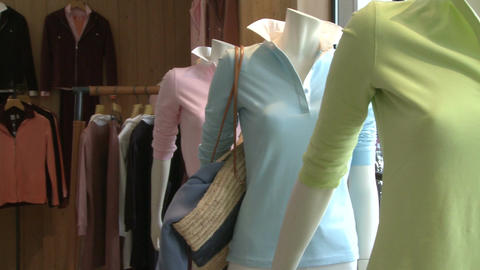 Clothes being display in a designer clothing store (2 of 2) Live Action