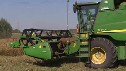 Harvester machine trash peas plants in agricultural field Footage