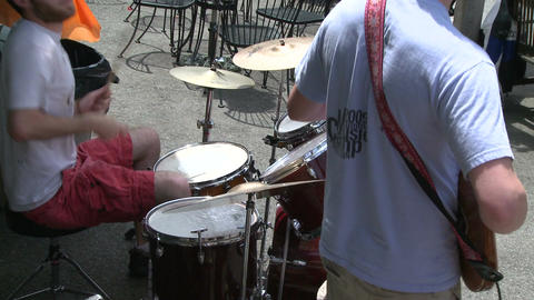 Guitar player and a drummer playing in a band (2 of 3) Live Action