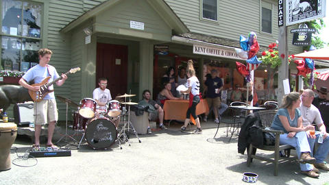 Guitar player and drummer playing in front of a Country Store (1 of 2) GIF