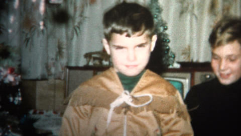 (8mm Vintage) 1965 Boy Gets Indian Costume for Christmas Gift Footage