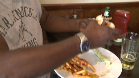 Man eating hamburger with french fries (1 of 2) Footage