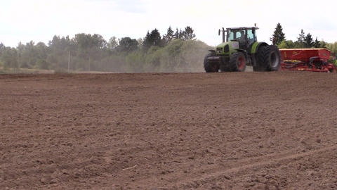agricultural tractor starts a chemical fertilizing on soil Footage