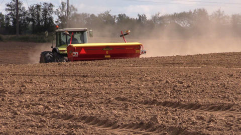Tractor fertilize soil in field. Time of sowing. Planting crops Footage